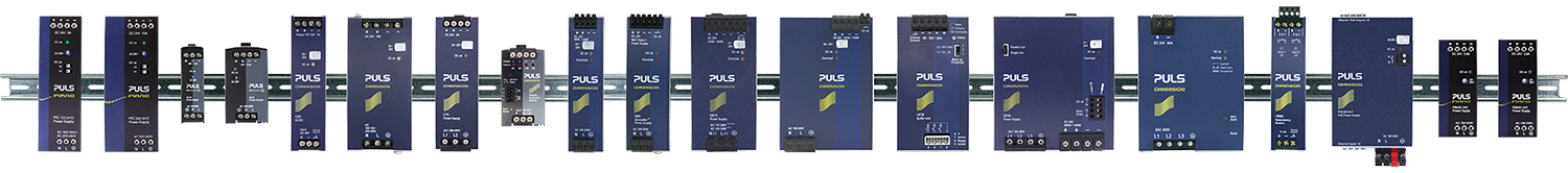 Various PULS DIN rail power supplies on the DIN rail.